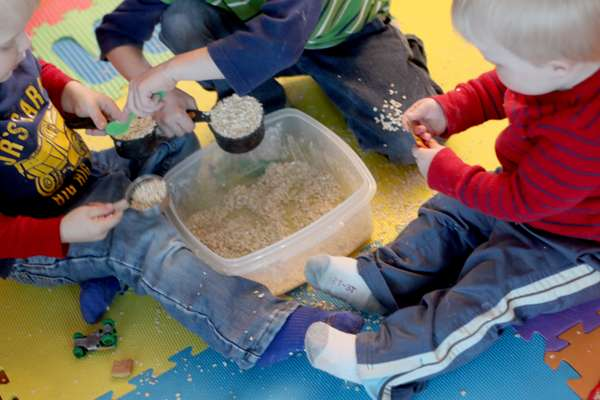 Kids playing in their indoor sandbox