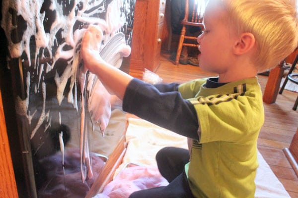 Playing with soapy sensory foam cleans too!