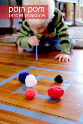 Pom pom target practice -- by blowing!