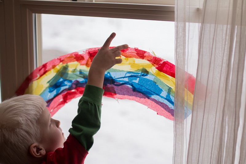 A rainbow suncatcher made with the three primary colors to add a twist of learning about color mixing too!
