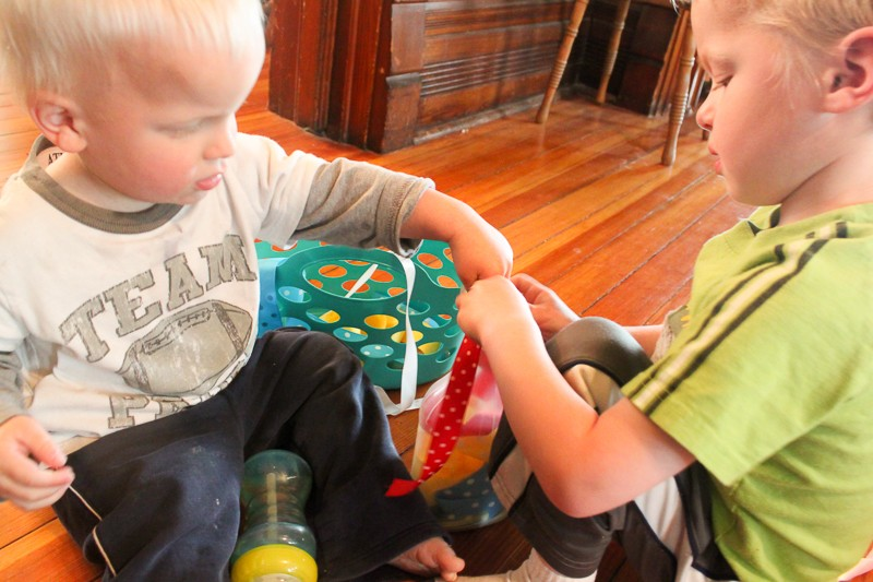 Fine motor play with ribbon -- great busy idea for toddlers to do