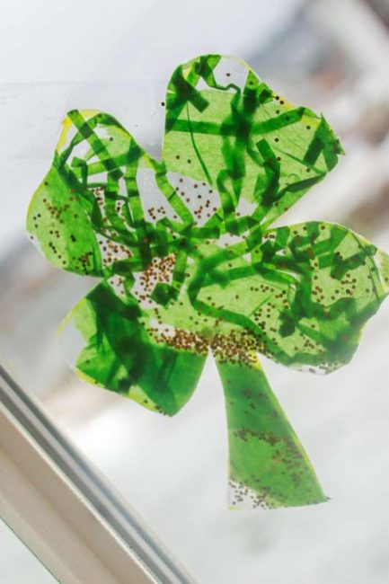 Easy toddler shamrock window craft for st patricks day easy shamrocks for toddlers to make to hang in the window voltagebd Images