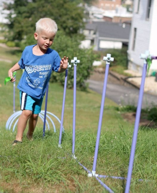 Slalom activity in an obstacle course for kids using Fort Magic pieces