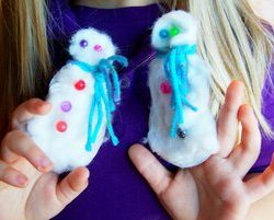 Make a snowy friend with snowman puppets from Hands On As We Grow