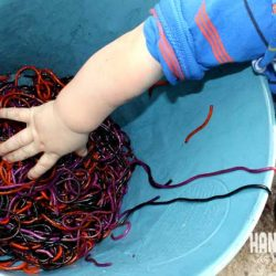 Slimy spaghetti sensory bin for kids