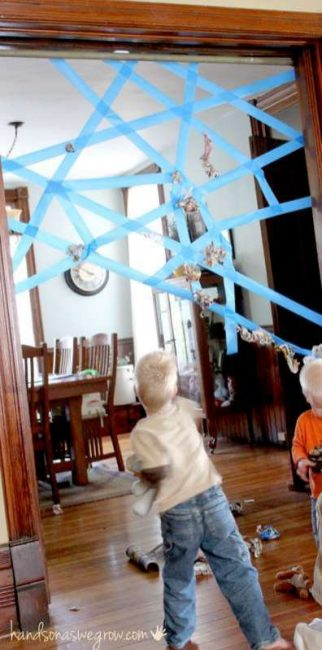 Use tape to make a spider web in the doorway