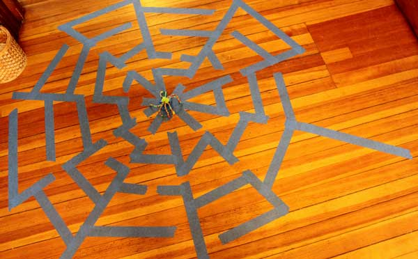 Spider web maze with tape on the floor