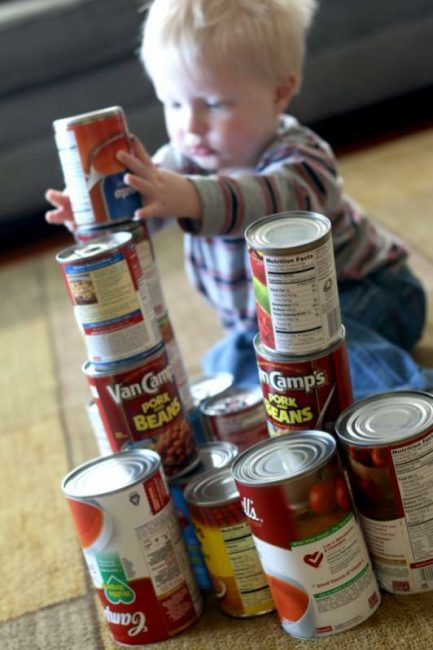 Stacked canned food as blocks for toddlers