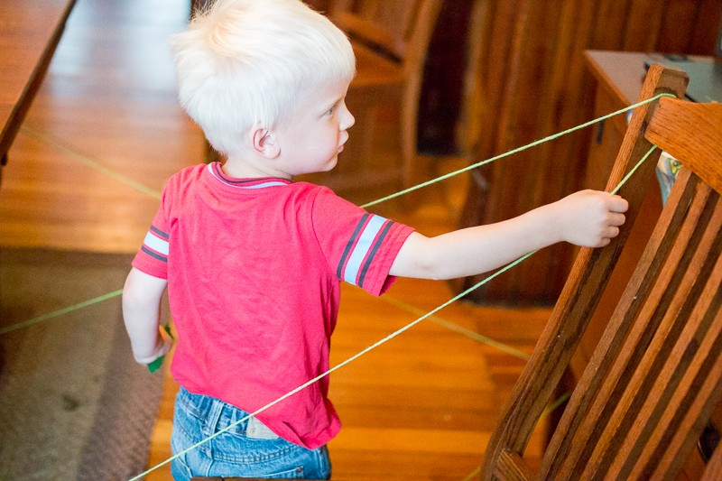 An indoor obstacle course or scavenger hunt to follow the string