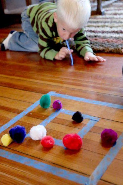 Easy target practice for preschoolers using pom poms