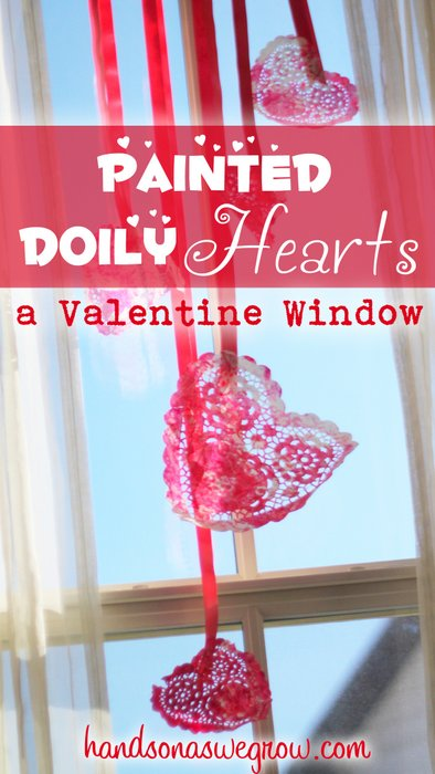 Valentine Window of Toddler Painted Doily Hearts