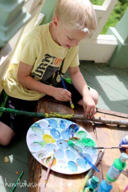 kids painting their own walking sticks