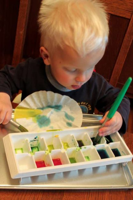Kid can paint coffee filters to make colored flowers