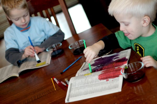 The boys painted newsprint [phonebook] with watercolors