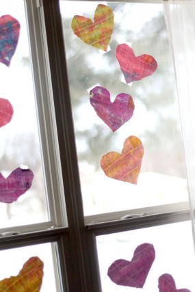 Painting watercolor hearts to hang on the window for Valentine's Day
