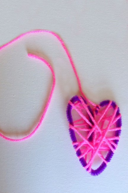 Yarn wrapped hearts are a great fine motor activity for little kids to make and display!